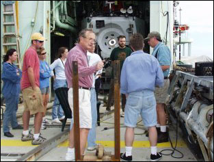 Scientists clustered around Argo II. Photo by Monte Basgall. Nicholas School of the Environment, Duke University.