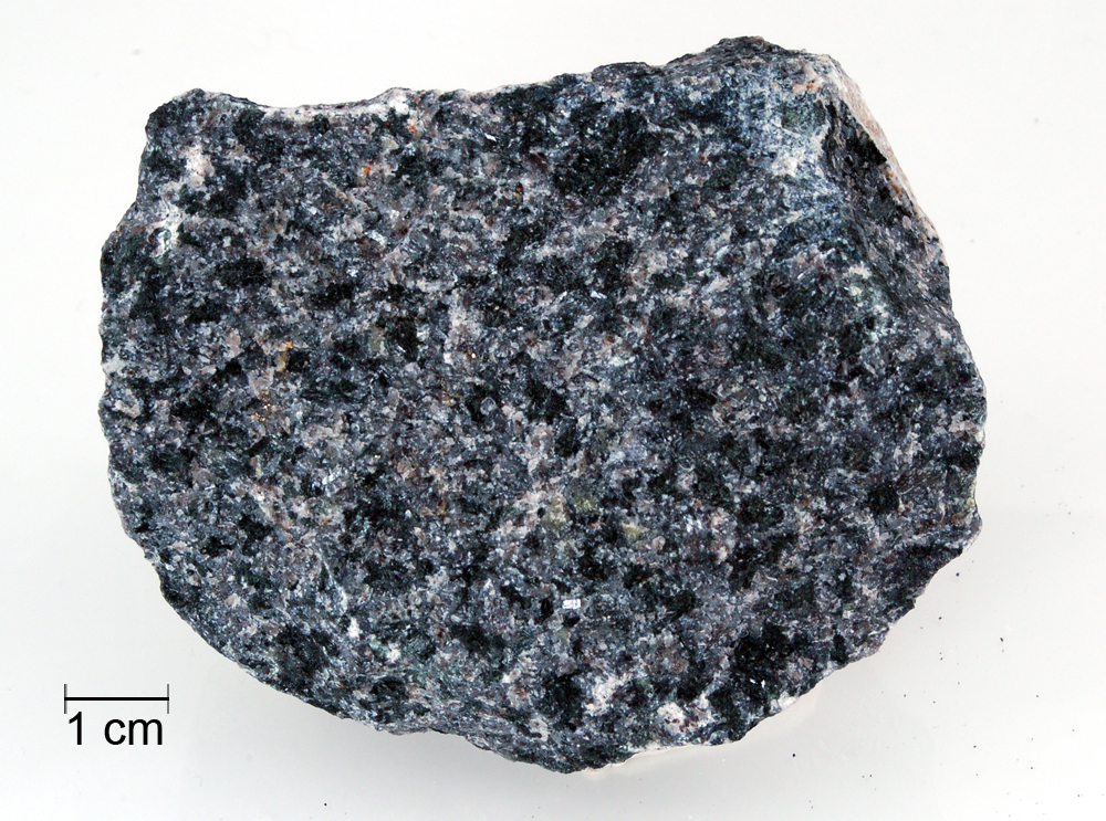 igneous rocks Intrusive, or plutonic, igneous rocks form when magma cools slowly below the earth's surfacemost intrusive rocks have large, well-formed crystals examples include granite, gabbro, diorite and dunite.